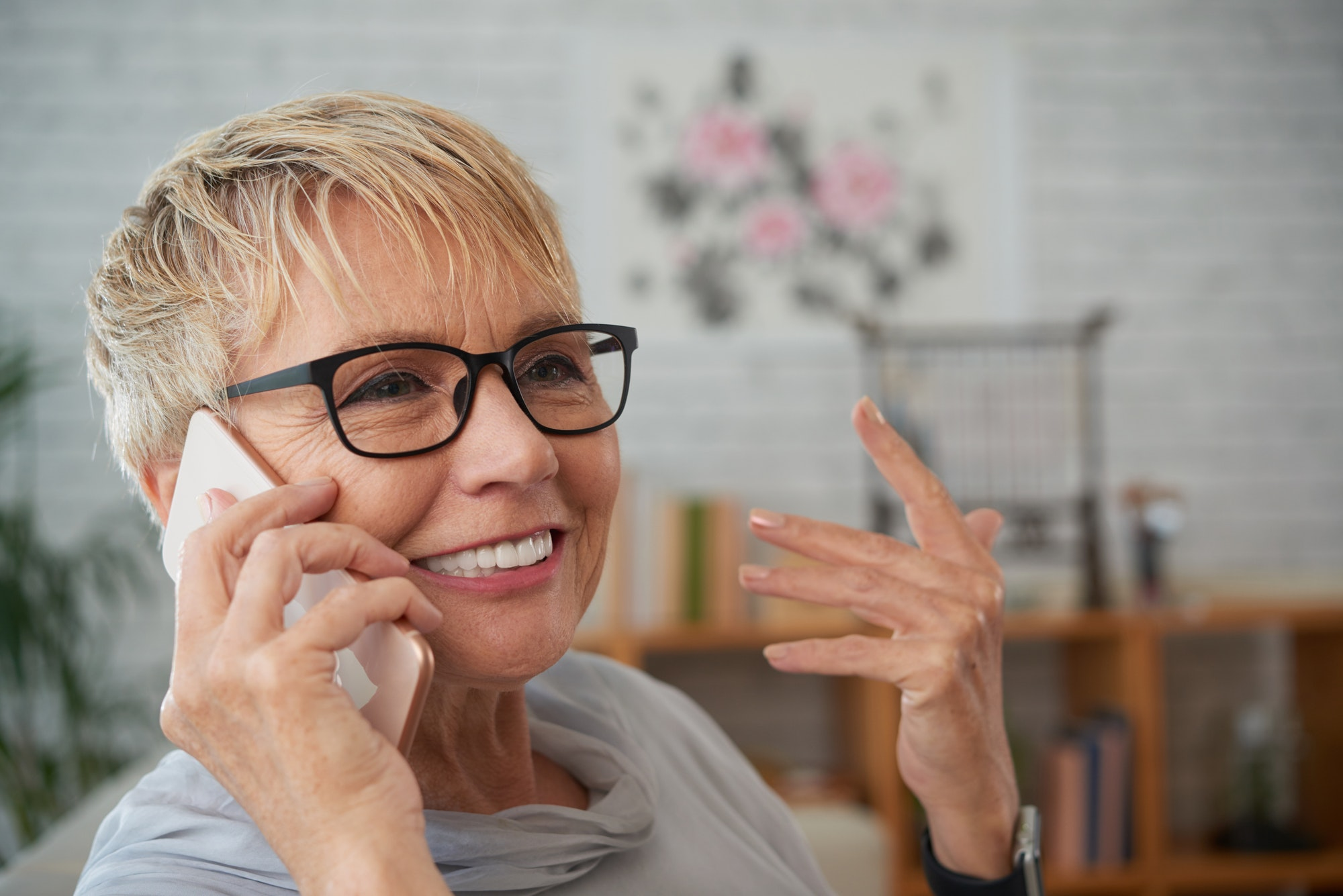 Smiling old woman talking on phone